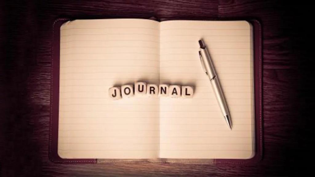 Journal et stylo