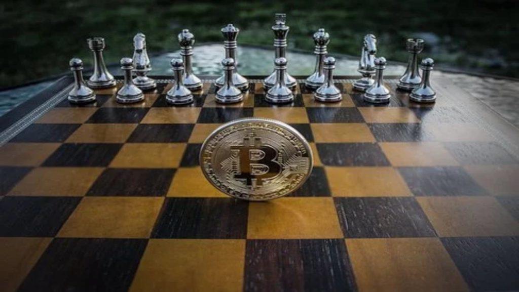 Jeu d'échecs avec un jeton Bitcoin